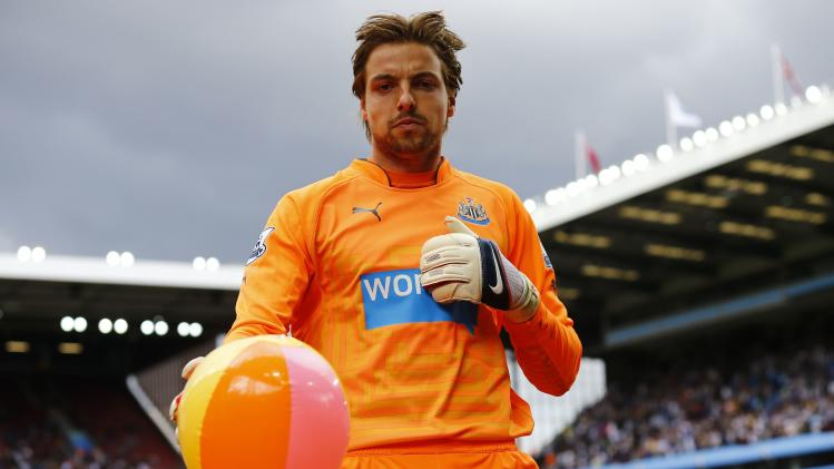 Newcastle United's goalkeeper Krul removes a beach ball from the pitch during their English Premier League soccer match against Aston Villa at Villa Park in Birmingham