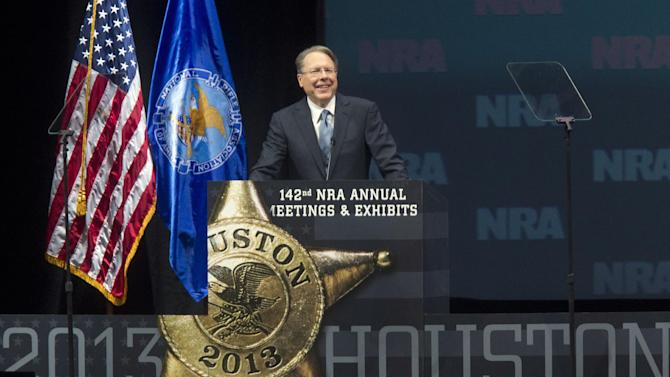 Wayne LaPierre, executive vice president of the NRA, speaks during the NRA Annual Meeting of Members at the National Rifle Association's 142 Annual Meetings and Exhibits in the George R. Brown Convention Center Saturday, May 4, 2013, in Houston. National Rifle Association leaders told members Saturday that the fight against gun control legislation is far from over, with battles yet to come in Congress and next year's midterm elections, but they vowed that none in the organization will ever have to surrender their weapons. (AP Photo/Houston Chronicle, Johnny Hanson)
