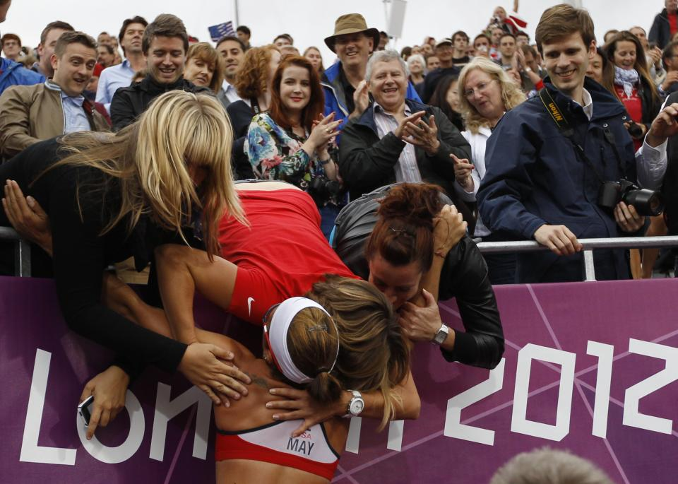 US Misty May-Treanor celebrates with her frriends and fans after defeating China in the semifinal women's beach volleyball match at the 2012 Summer Olympics, Tuesday, Aug. 7, 2012, in London. (AP Photo/Petr David Josek)