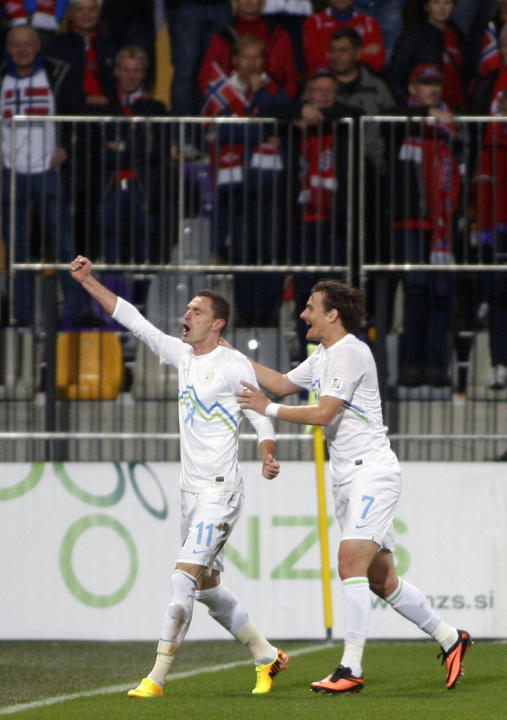 Slovenia's Milivoje Novakovic, left, and Nejc Pecnik, celebrate Slovenia's opening goal during the 2014 World Cup group E qualifier soccer match between Slovenia and Norway in Maribor, Slovenia, Frida