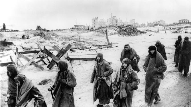 FILE - In this early 1943 photo, captured German soldiers, their uniforms tattered from the battle, make their way in the bitter cold through the ruins of Stalingrad, Russia. On Saturday, Feb. 2, 2013, Russia marks the 70th anniversary of the end of the Battle of Stalingrad, considered a turning point in World War II. (AP Photo/hpr, File)