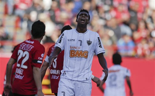 Joao Alves de Assis, center, of Brazil's Atletico Mineiro reacts after missing a shot on goal against Mexico's Club Tijuana Xoloitzcuintles during the first half of their Copa Libertadores quarterfina