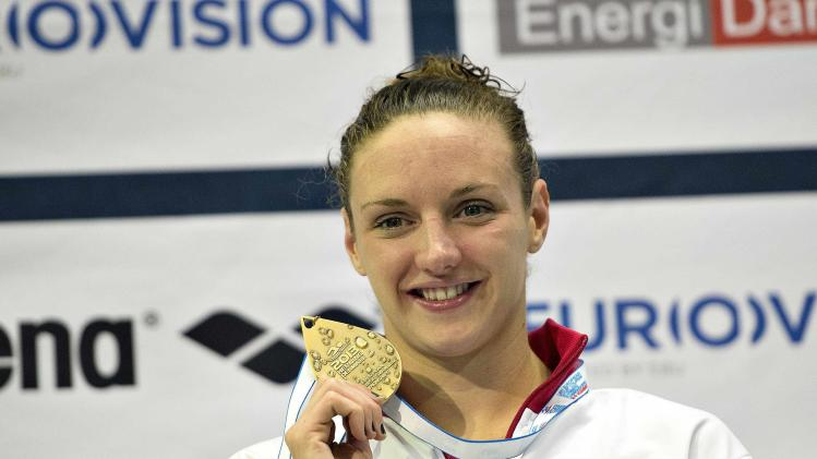 Hosszu of Hungary poses with her gold medal during the women's 200m individual medley victory ceremony of the 2013 European Short Course Swimming Championships in Herning