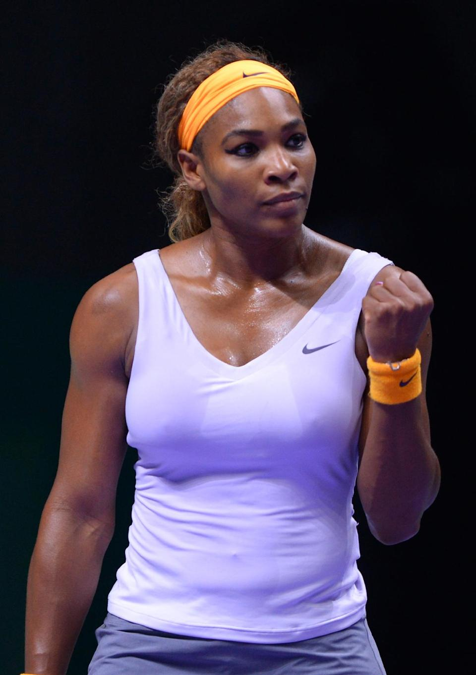 Serena Williams of the U.S reacts after she returned a shot to Li Na of China during their final tennis match at the WTA Championship in Istanbul, Turkey, Sunday, Oct. 27, 2013. The world's top female tennis players compete in the championships which runs from Oct. 22 until Oct. 27.(AP Photo)