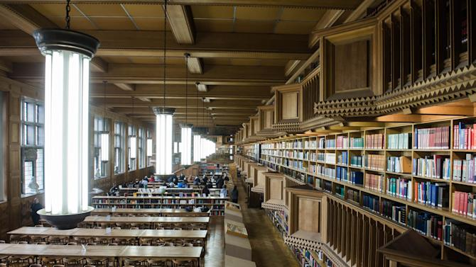 In this picture taken on Monday, Jan. 6, 2014, the interior of the Leuven University Library in Leuven, Belgium. The German invading forces set the heart of Leuven alight during the early days of World War I, paying special attention to the gem of learning and history, the university library. The library was later rebuilt with donations coming from around the world. (AP Photo/Geert Vanden Wijngaert)
