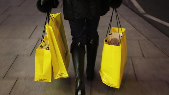 A woman carries shopping bags on Oxford Street in London