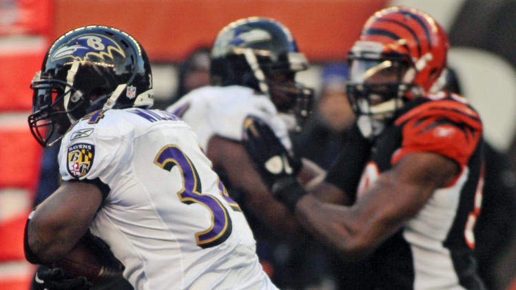 Baltimore Ravens running back Ricky Williams runs against the Cincinnati Bengals in the second half of an NFL football game, Sunday, Jan. 1, 2012, in Cincinnati. Baltimore won 24-16. (AP Photo/Tony Tribble)