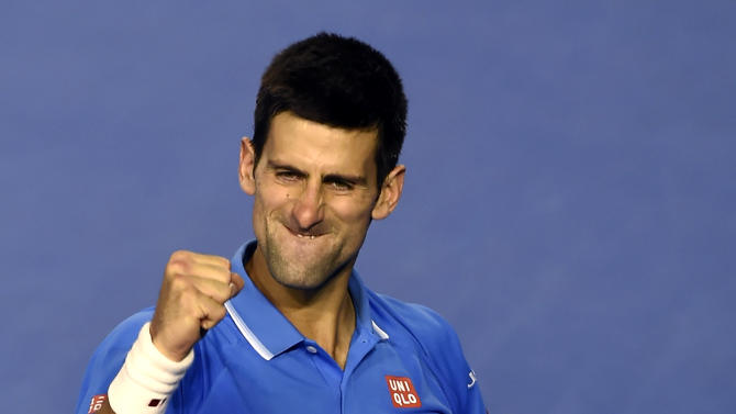 Novak Djokovic of Serbia celebrates after defeating Stan Wawrinka of Switzerland in their semifinal at the Australian Open tennis championship in Melbourne, Australia, Friday, Jan. 30, 2015. (AP Photo/Andy Brownbill)