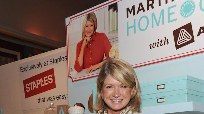 COMMERCIAL IMAGE - Martha Stewart demonstrates organization solutions from the Martha Stewart Home Office with Avery product line sold exclusively at Staples at the Staples booth during BlogHer, the nation's largest blogging conference, Friday, Aug. 3, 2012, in New York.(Photo by Diane Bondareff/Invision for Staples/AP Images)
