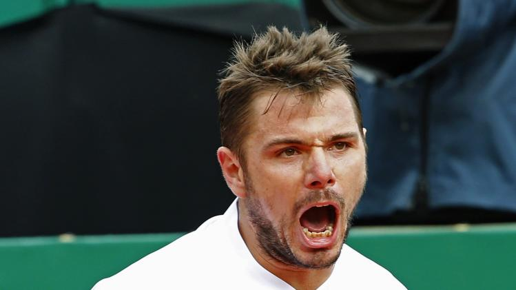 Wawrinka of Switzerland reacts during the final tennis match against compatriot Federer at the Monte Carlo Masters in Monaco