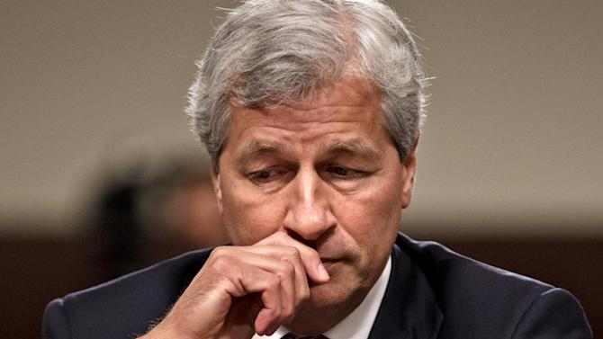 FILE - In this June 13, 2012 file photo, JPMorgan Chase CEO Jamie Dimon, head of the largest bank in the United States, testifies on Capitol Hill in Washington, before the Senate Banking Committee about how his company recently lost more than $2 billion on risky trades. Throughout 2012, banks faced scrutiny as drama ensued. JPMorgan Chase lost $6 billion in a complex series of trades. (AP Photo/J. Scott Applewhite, File)