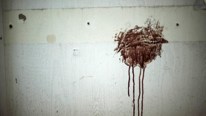 In this Wednesday, Sept. 19, 2012 photo, blood stains a wall in a hospital controlled by the Free Syrian Army in Aleppo, Syria.(AP Photo/Manu Brabo)