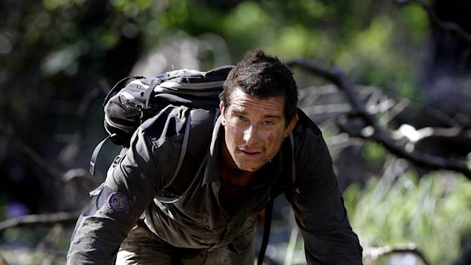 """In this May 25, 2010 publicity image released by Discovery Channel, adventurer Bear Grylls is shown at Mount Borradaile in Australia's north-western Arnhemland during filming of the series, """"Man vs. Wild."""" NBC said Monday, Oct. 8, 2012, that it is making a competition series with Grylls. The NBC series, """"Get Out Alive,"""" is planned for airing next summer. In it, Grylls will guide two teams in adventures. He says competitors will learn survival skills and teamwork but will have to suffer some pain before being rewarded in the end. (AP Photo/Discovery Channel, Luis Enrique Ascui)"""