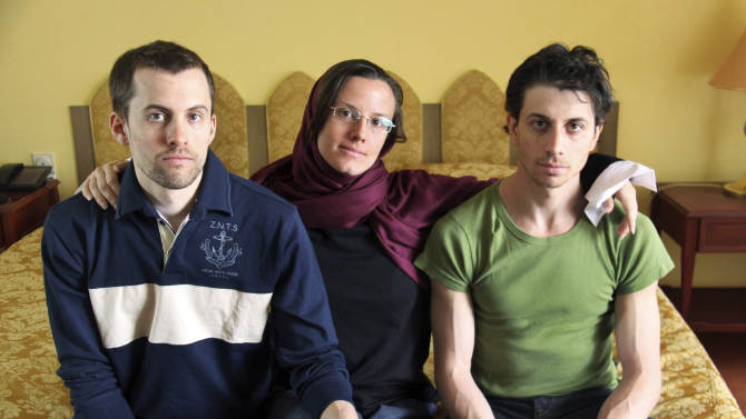 FILE - In this May 20, 2010 file photo, American hikers Shane Bauer, left, Sarah Shourd, center, and Josh Fattal, sit at the Esteghlal Hotel in Tehran, Iran.  Shane Bauer and Sarah Shourd detained and accused of spying after hiking near the Iraq-Iran border three years ago will marry Saturday, May 5, 2012 in the San Francisco Bay area.  (AP Photo/Press TV, File)