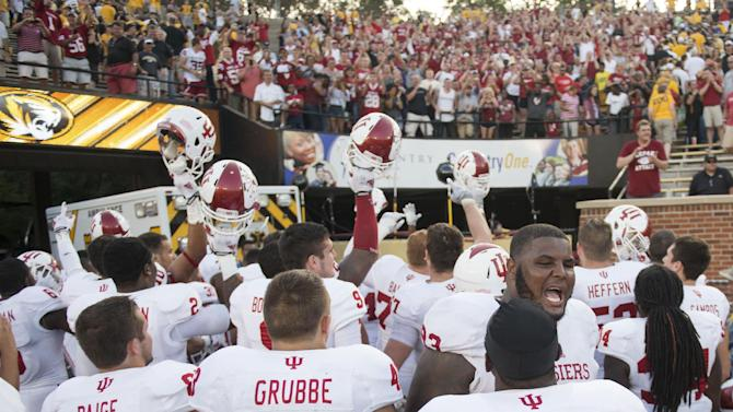 The Indiana football team celebrates in front of fans after Indiana upset Missouri, 31-27, in an NCAA college football game Saturday, Sept. 20, 2014, in Columbia, Mo