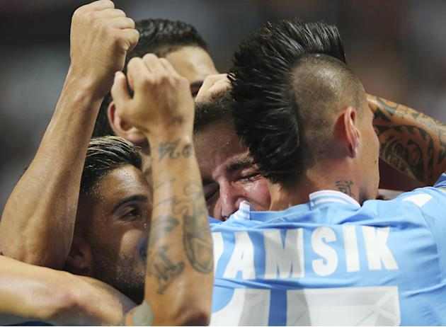 Napoli forward Gonzalo Higuain, second from right, of Argentina, celebrates with his teammates Marek hamsik, of Slovakia, right, and Lorenzo Insigne, left, after scoring during the Serie A soccer matc