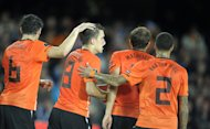 Dutch Kevin Strootman , second left, who scored the team&#39;s first goal is congratulated by Mark van Bommel (L), Joris Mathijsen and Gregory van der Wiel during the UEFA Euro 2012 Group E qualifying football match Finland vs the Netherlands at the Olympic Stadium in Helsinki, Finland, on Tuesday Sept. 6, 2011. (AP Photo/LEHTIKUVA / Martti Kainulainen ) FINLAND OUT. NO THIRD PARTY SALES.