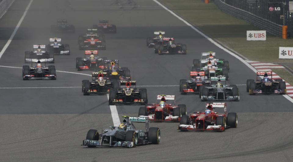 Mercedes driver Lewis Hamilton of Britain  leads the field into turn one at the start of  the Chinese Formula One Grand Prix in Shanghai, China, Sunday, April 14, 2013. (AP Photo/Greg Baker)