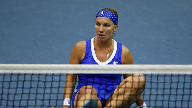 Kuznetsova of Russia sits on the court after falling during her FedCup World Group first round tennis match against Hogenkamp of Netherlands in Moscow.