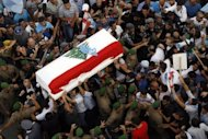 The coffin of General Wissam al-Hassan arrives in Beirut. Lebanese police fired in the air and used tear gas on Sunday to repel protesters trying to storm the premier's office, amid calls for him to quit after the top security official was killed by a car bomb blamed on Syria