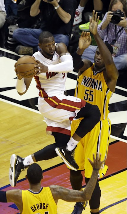 Miami Heat guard Dwyane Wade (3) looks to pass the ball as Indiana Pacers center Roy Hibbert (55) and forward Paul George (24) defend during the second half of Game 2 in their NBA basketball Eastern C