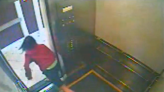 This still image taken from a security video was released on Feb. 13, 2013, by the Los Angeles Police Department in connection with the search for 21-year-old missing Canadian tourist Elisa Lam. In this image, a woman believed to be Lam quickly peeks out the door of an elevator before jumping back inside in the Cecil Hotel in downtown Los Angeles on Thursday, Jan. 31, the last day she was seen alive. A maintenance worker at the hotel found Lam's body in a water cistern on the building's roof on Feb. 19, more than two weeks after she had gone missing. (AP Photo/Los Angeles Police Department)