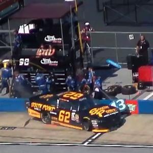 Two members of No. 98 crew clipped on pit road