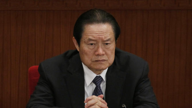 In this photo taken Friday, March 9, 2012, Zhou Yongkang, then Chinese Communist Party Politburo Standing Committee member in charge of security, attends a plenary session of the National People's Congress at the Great Hall of the People in Beijing, China. China's Communist Party says it has launched an investigation into the former domestic security chief who was once among the country's most feared leaders. The official Xinhua News Agency cited the party as saying Tuesday, July 29, 2014 it is investigating Zhou for serious violations of party discipline, but did not provide details. (AP Photo/Ng Han Guan)