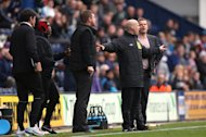 Karl Robinson, left, believes MK Dons should have had a penalty late on against Preston