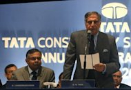 Chairman of Tata Consultancy Services, Ratan Tata (R) speaks during the annual general meeting of TCS in Mumbai. TCS warned Friday of &quot;weakness&quot; in global markets, marking the latest downbeat comment to emerge from the country&#39;s flagship software industry