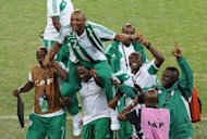 Nigeria's head coach Stephen Keshi (C) is carried by staff members as they celebrate winning the 2013 African Cup of Nations final against Burkina Faso on February 10, 2013 at Soccer City stadium in Johannesburg. African champions Nigeria will face Mexico in a high-profile friendly in Houston, Texas, on May 31.