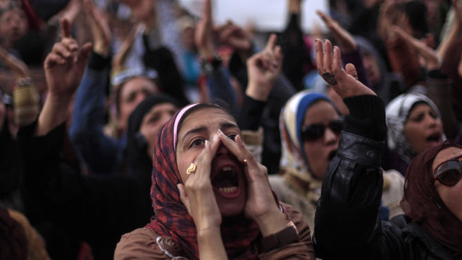 Egyptian protesters chant anti-government slogans during a rally in Tahrir Square, Cairo, Egypt, Friday, Feb. 1, 2013. Thousands of Egyptians marched across the country, chanting against the rule of the Islamist President Mohammed Morsi, in a fresh wave of protests Friday, even as cracks appeared in the ranks of the opposition after its political leaders met for the first time with the rival Muslim Brotherhood. (AP Photo/Khalil Hamra)