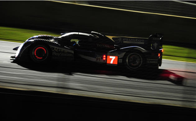 \Simon Pagenaud, of France, goes through a corner in his Peugeot during night practice for the American Le Mans Series' Petit Le Mans auto race at Road Atlanta, Thursday, Sept. 29, 2011, in Braselton,