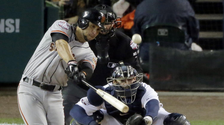San Francisco Giants' Gregor Blanco hits an RBI triple during the second inning of Game 3 of baseball's World Series  against the Detroit Tigers Saturday, Oct. 27, 2012, in Detroit.  (AP Photo/Charlie Riedel)