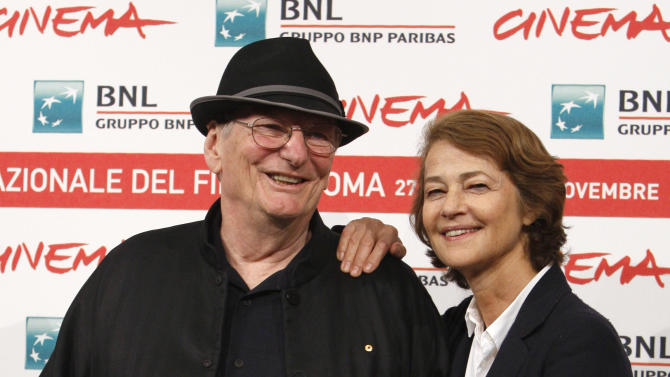 "Australian director Fred Schepisi, left, poses with British actress Charlotte Rampling during a photocall to present his new movie ""The eye of the storm"" at the 6th edition of the Rome International Film Festival in Rome, Sunday, Oct. 30, 2011. (AP Photo/Riccardo De Luca)"