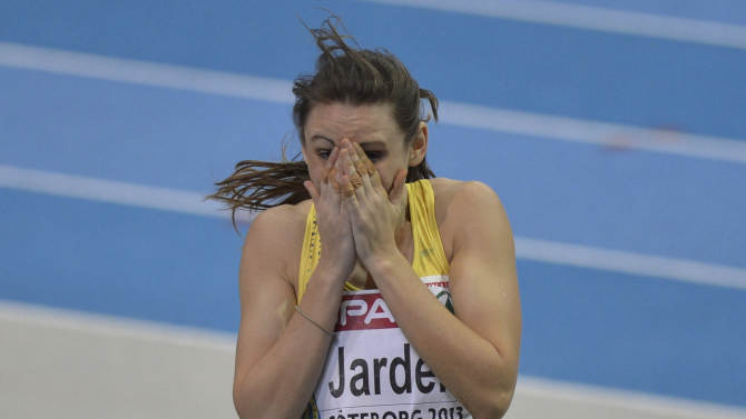 Sweden's Erica Jarder reacts after winning bronze in the women's long jump during the Athletics Indoors European Championships in Gothenburg, Sweden, Saturday, March 2, 2013. (AP Photo/Martin Meissner)