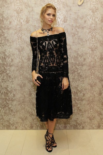 Rethink your safe little black dress by choosing one in a gorgeous lace fabric with a modern, off-the-shoulder neckline, and add a choker to show if off. Keep your hair messy and simple, and add a cha