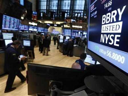 The trading symbol for Blackberry is seen on a screen on the floor at ...