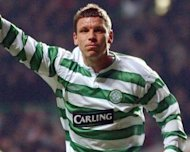 Celtic first-team coach Alan Thompson, seen playing for the club in 2004, has left the club, the Scottish champions have confirmed