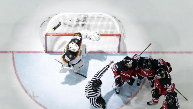 Canada's players celebrate a goal past Germany's goaltender Endras during their Ice Hockey World Championship game at the O2 arena in Prague