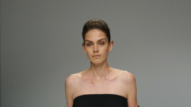 A model wears a creation for Belgian born fashion designer Veronique Branquinho's Spring Summer 2013 ready to wear collection, in Paris, Tuesday, Sept.25, 2012. (AP Photo/Jacques Brinon)