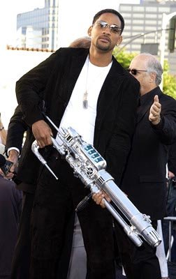 Will Smith prepares to bust an intergalactic cap up at the LA premiere of Columbia's Men in Black II