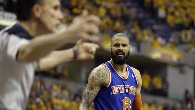 New York Knicks' Tyson Chandler (6) reacts after being called for a foul by referee Ken Mauer, left, during the first half of Game 6 of an Eastern Conference semifinal NBA basketball playoff series against the Indiana Pacers, Saturday, May 18, 2013, in Indianapolis. (AP Photo/Darron Cummings)
