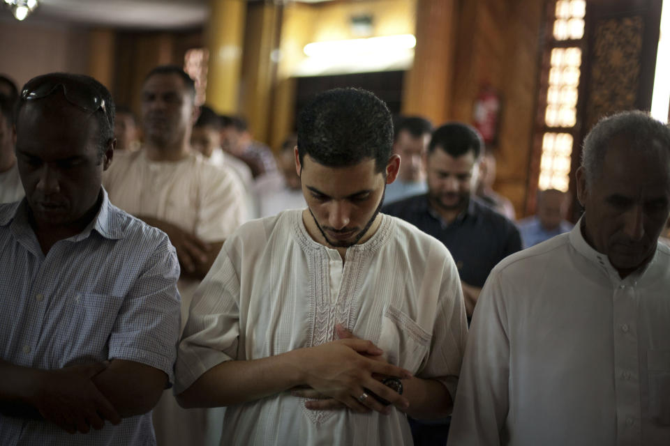 Libyan men pray during the reflection day at the main mosque in Tripoli, Libya, Friday, July 6, 2012. The Libyan National Assembly elections - the first free election since 1969-will take place on July 7, 2012. (AP Photo/Manu Brabo)
