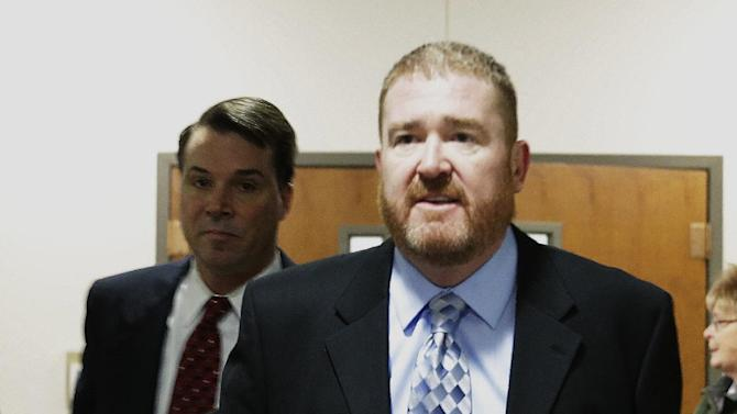 Defense attorney Daniel King arrives at district court for the arraignment of James Holmes, Aurora theater shooting suspect, in Centennial, Colo., on Tuesday, March 12, 2013. Holmes is charged with killing 12 people and wounding more than 50 in a crowded Colorado movie theater last year. The hearing was delayed as King arrived 30 minutes late because of weather and traffic. (AP Photo/Ed Andrieski)