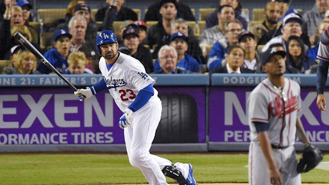 Los Angeles Dodgers' Adrian Gonzalez, left, watches his two-run home run off Atlanta Braves starting pitcher Julio Teheran, right, during the fifth inning of a baseball game, Tuesday, May 26, 2015, in Los Angeles. This was Gonzalez's 1000th career RBI. (AP Photo/Mark J. Terrill)