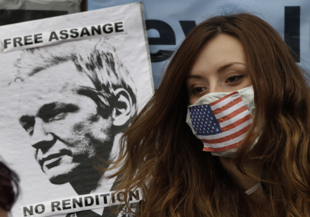 A supporter of WikiLeaks founder Julian Assange sits outside the Ecuadorian Embassy, in London, Friday, June 22, 2012. Assange entered the embassy on Monday in an attempt to gain political asylum to p