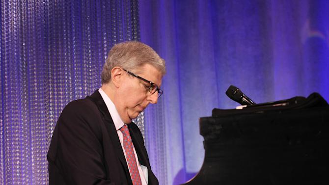 """FILE - In this Nov. 8, 2011 file photo originally released by Cedars-Sinai Medical Center, composer Marvin Hamlisch performs at the Cedars-Sinai Board of Governors Gala at The Beverly Hilton Hotel in Beverly Hills, Calif. Hamlisch, a conductor and award-winning composer best known for the torch song """"The Way We Were,"""" died Monday, Aug. 6, 2012 in Los Angeles. He was 68. (AP Photo/Cedars-Sinai Medical Center, Alex J. Berliner)"""