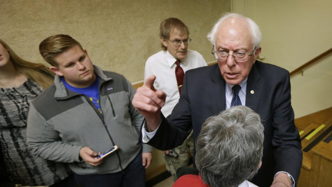"FILE-- This Dec. 16, 2014, file photo, Sen. Bernie Sanders, I-Vt., right, talks with local residents during a town hall meeting in Ames, Iowa. Sanders says he'll decide by March whether to launch a 2016 presidential campaign. He says if he does, it won't just be to nudge the debate to the left. Sanders, a socialist, tells The Associated Press he won't get into the race unless he thinks he can win. At a time of increasing wealth inequality, a populist message of taking on ""the billionaire class"" might resonate, he says. (AP Photo/Charlie Neibergall, File)"