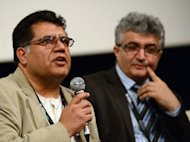 This photo taken on October 6, 2012 shows Afghan director Siddiq Barmak (L) speaking as Afghan producer Arify Ibrahim (R) listens during an open forum on Afghanistan's cinema history on the sidelines of the Busan International Film Festival (BIFF) in Busan